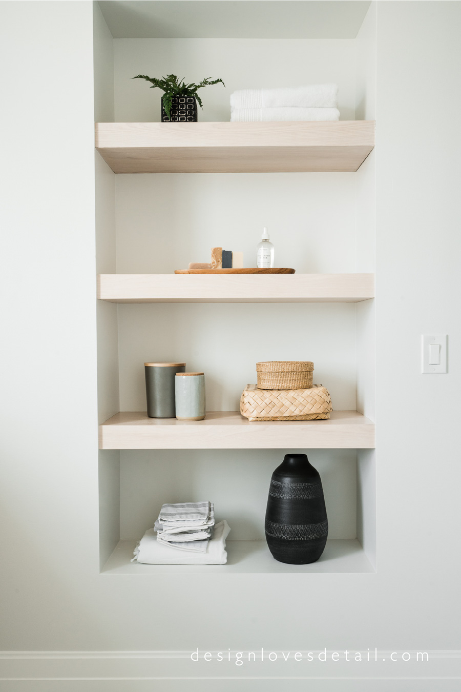 Gorgeous wood shelving in a bathroom designed by Mollie of Design Loves Detail