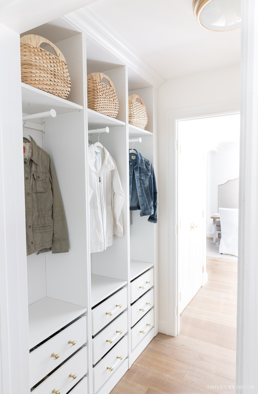 LOVE the built-in look of this open coat closet and drawers with shoe storage - made with IKEA PAX wardrobes!