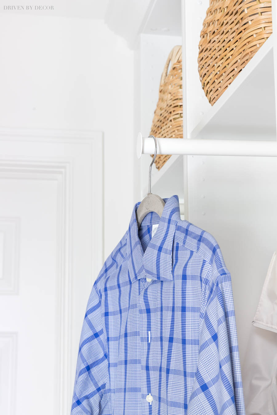 Love the clothes rail in this IKEA PAX coat closet that pull out for extra hanging space!
