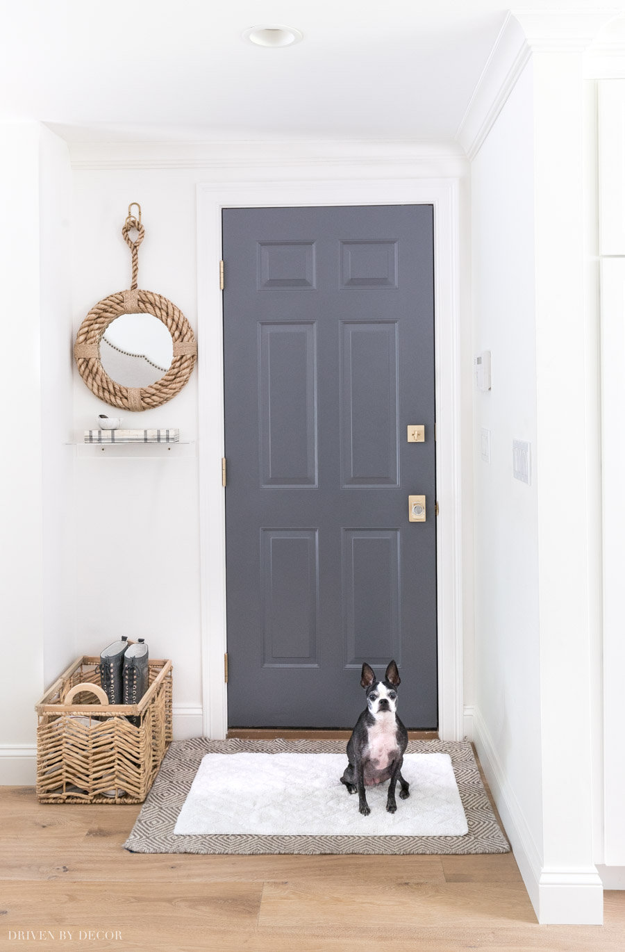 An easy to wash bathmat layered over a larger rug is a practical, stylish idea to keep dogs and kids from tracking dirt and mud into your home!