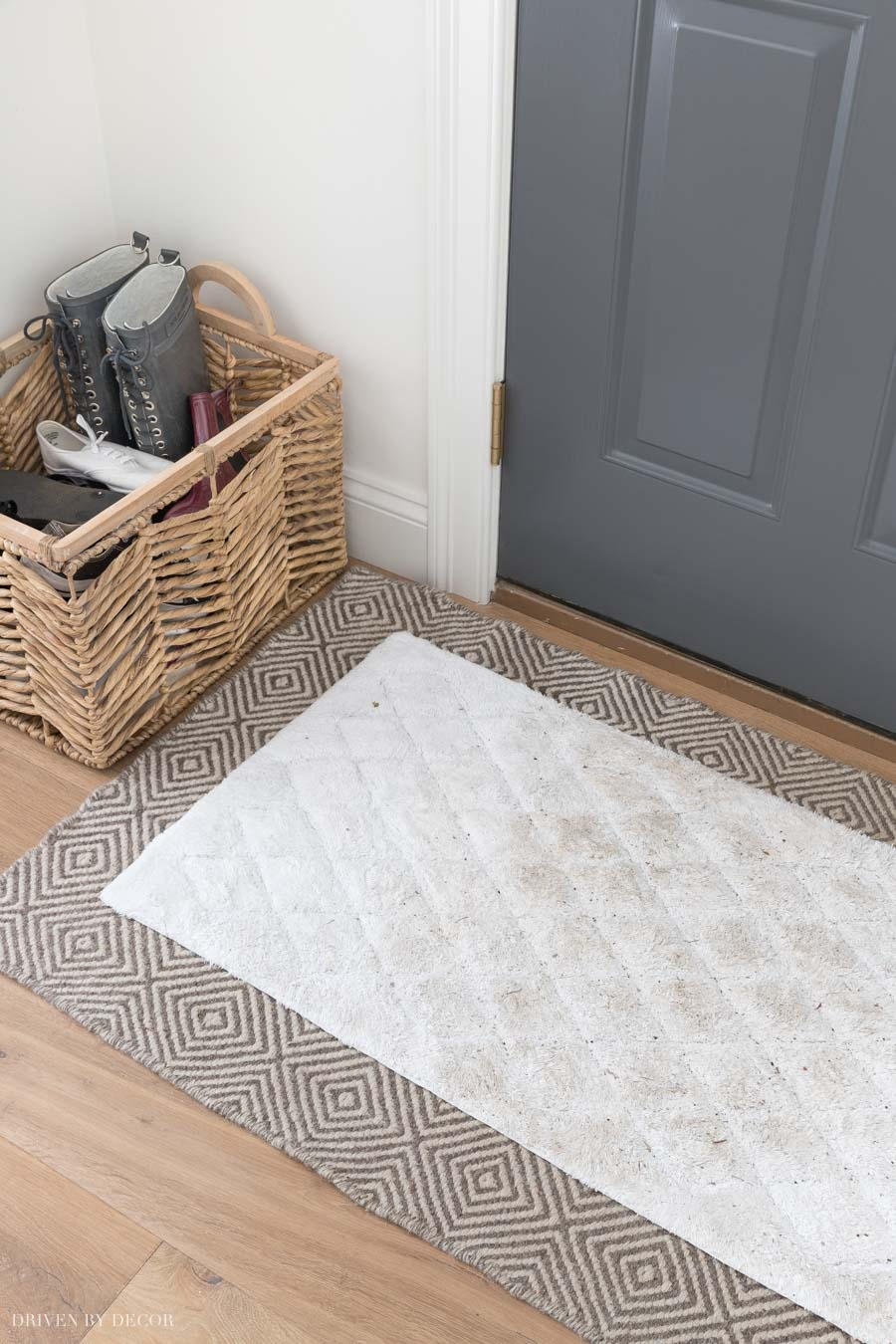 Smart idea to layer an easy to wash doormat over a patterned rug!