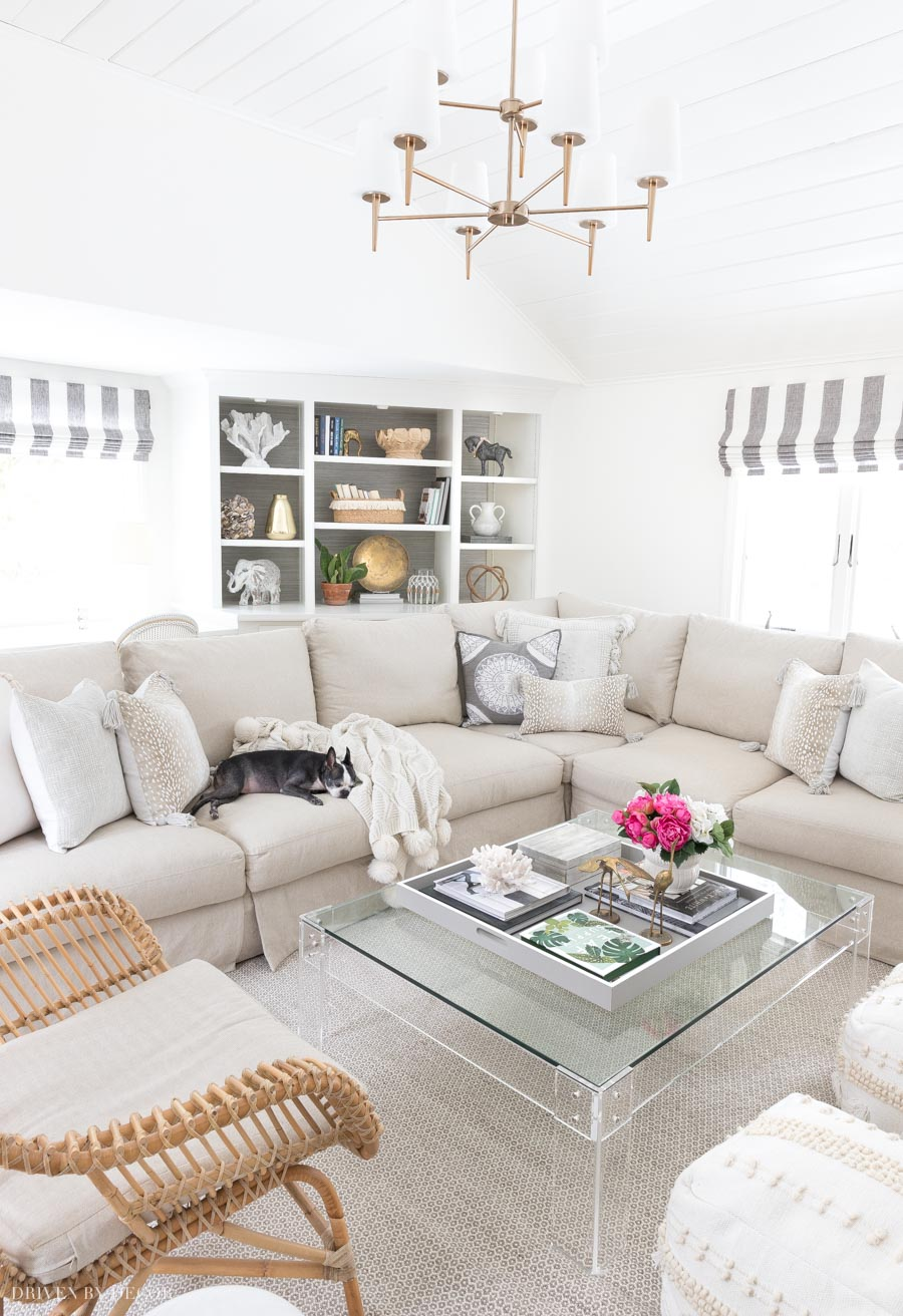 Great post on keeping a clean house with pets! Loving this slipcovered sectional!
