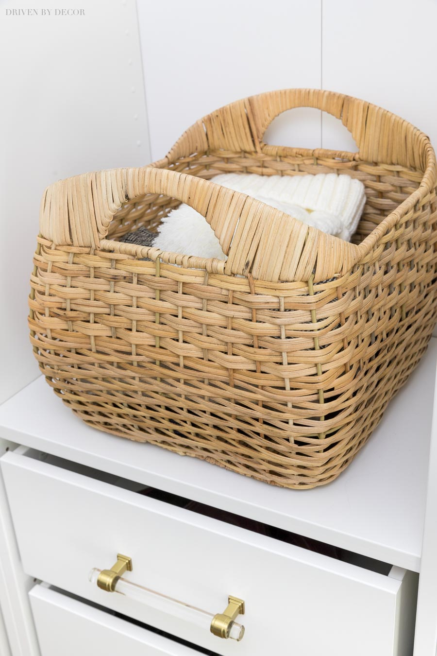 Pretty woven storage baskets for hats, scarves, and gloves in our coat closet.