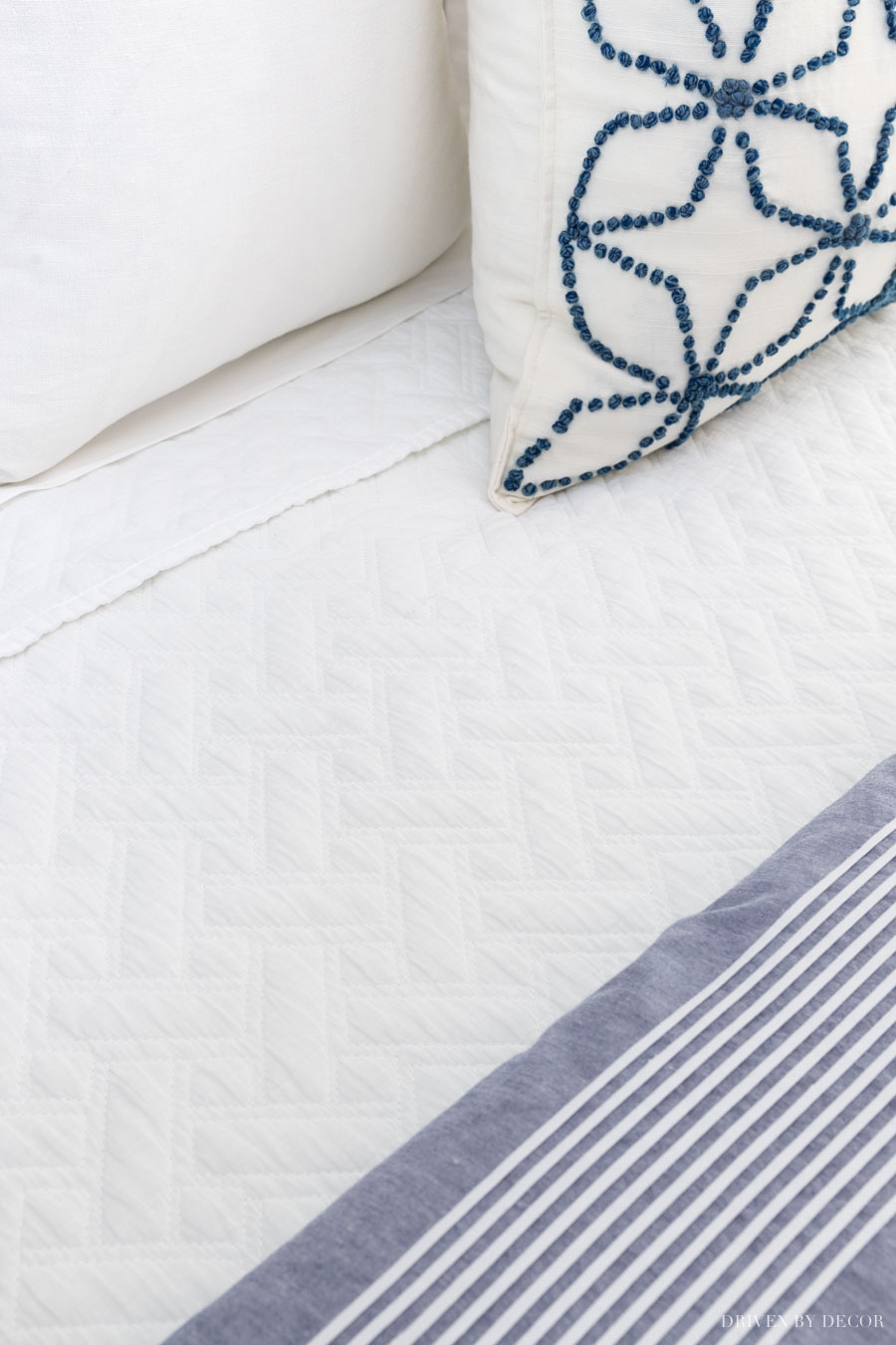 LOVE this basketweave coverlet! One of the bedding essentials in this bed making 101 post!