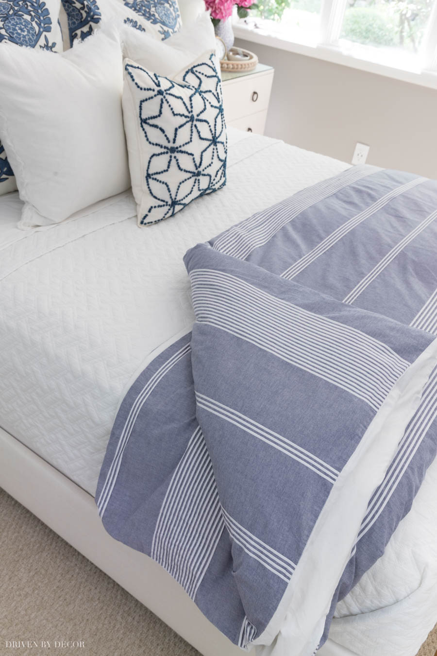 Crushing on this blue and white striped duvet! Looks so pretty folded at the foot of a bed!