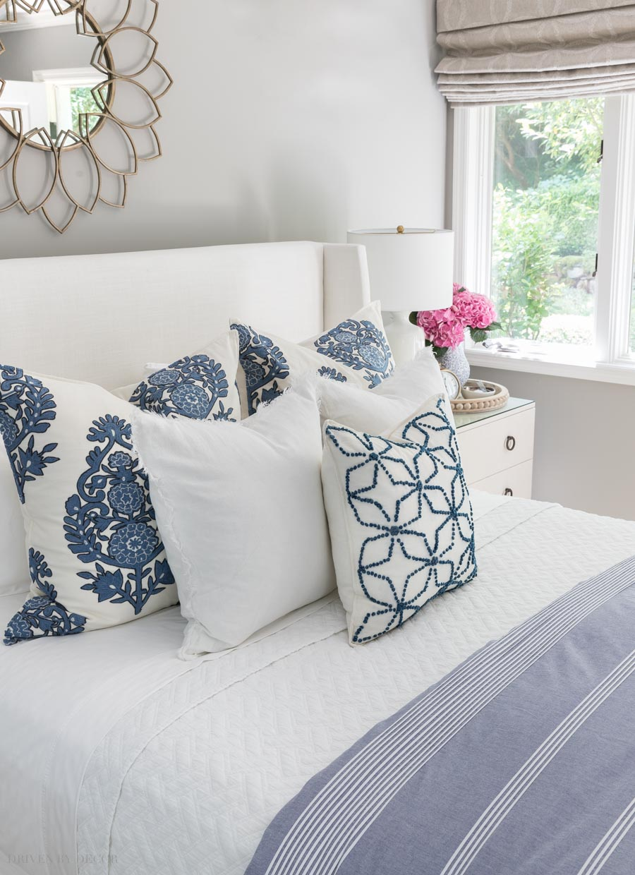 Crushing on this trio of blue and white throw pillows! Sources are linked in post!