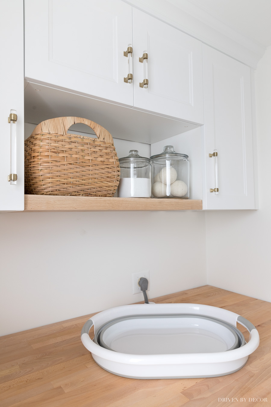 This collapsible laundry basket is perfect for storing in small spaces when not in use!