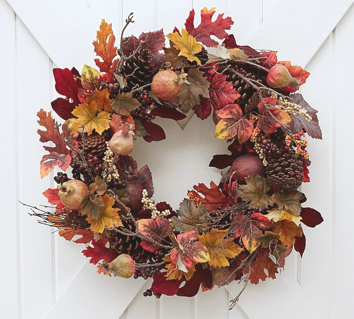 Beautiful fall wreath with faux leaves, pomegranates, and pinecones! This and other beautiful options are linked in the blog post!
