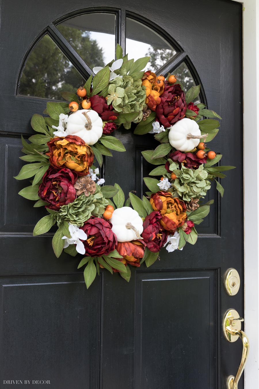 Love this fall wreath for my front door with pumpkins, pinecones, & hydrangeas