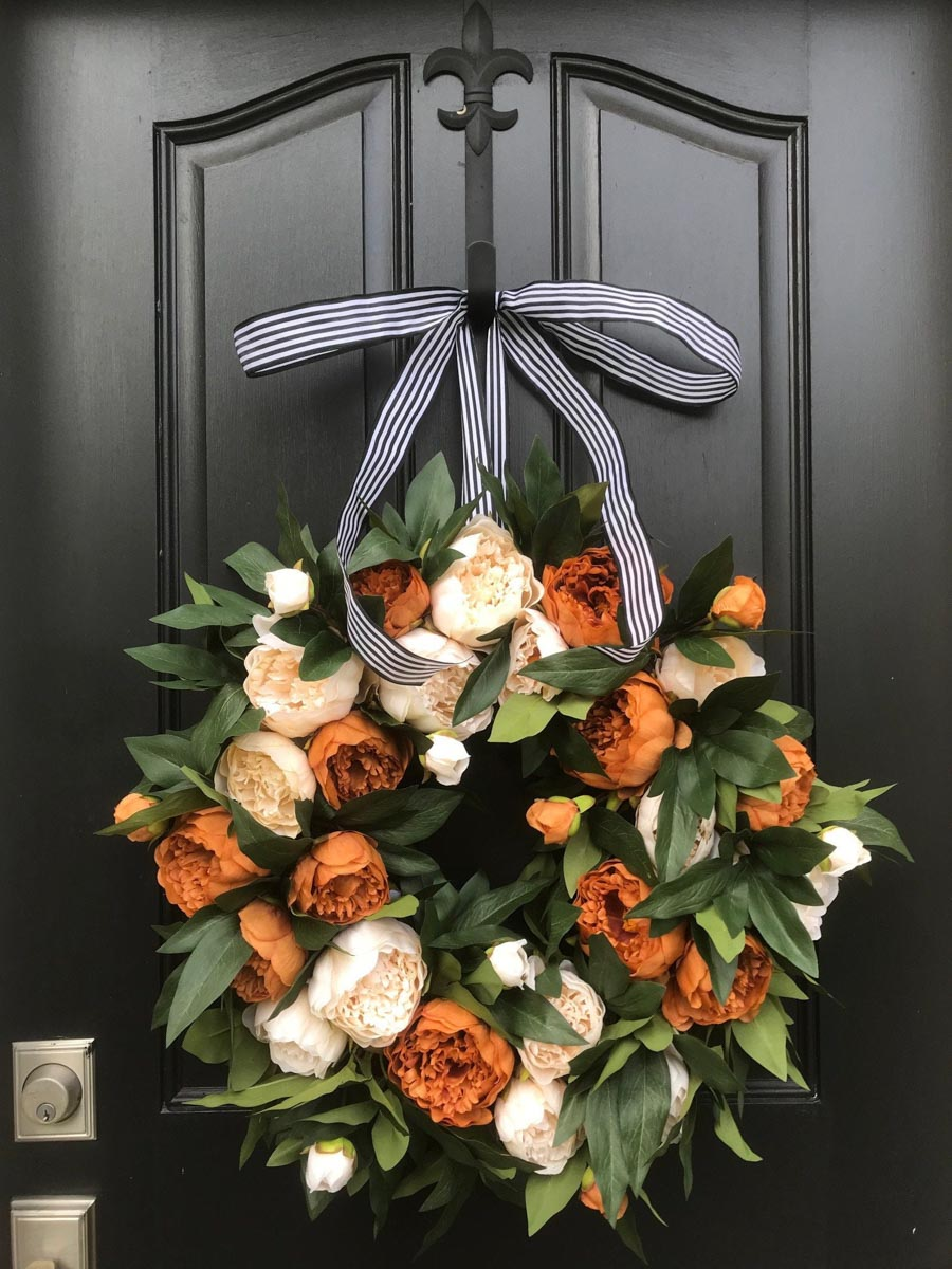 Absolutely gorgeous fall peony wreath! Perfect for dressing up your front door for fall!