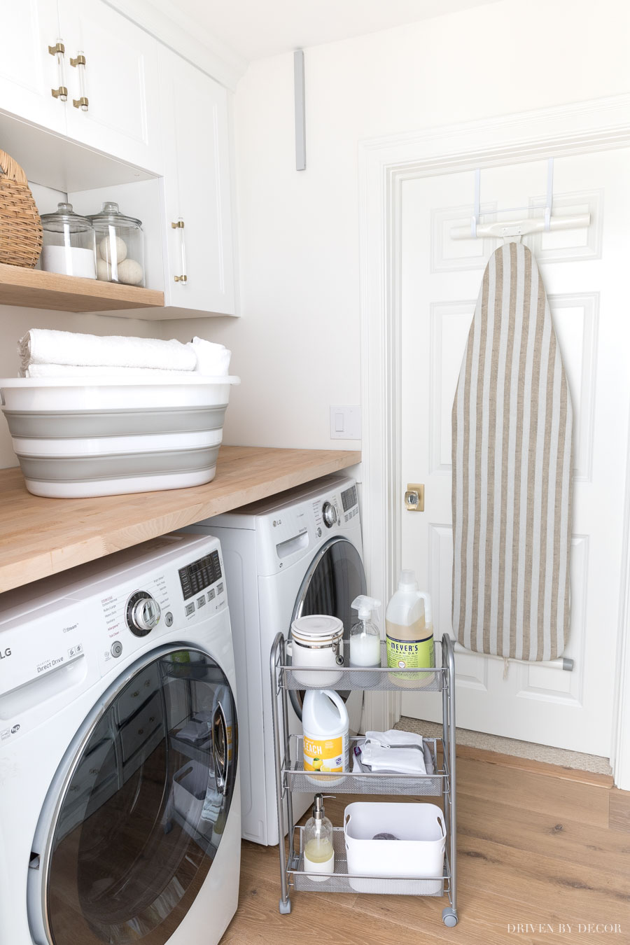 This rolling cart for between the washer and dryer is so smart! One of my favorite laundry room storage ideas!
