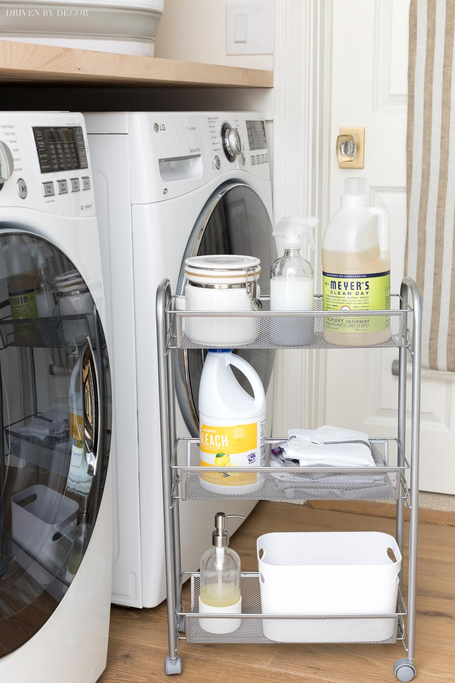 This slim rolling storage cart that goes between the washer and dryer for smart laundry room storage is everything!!