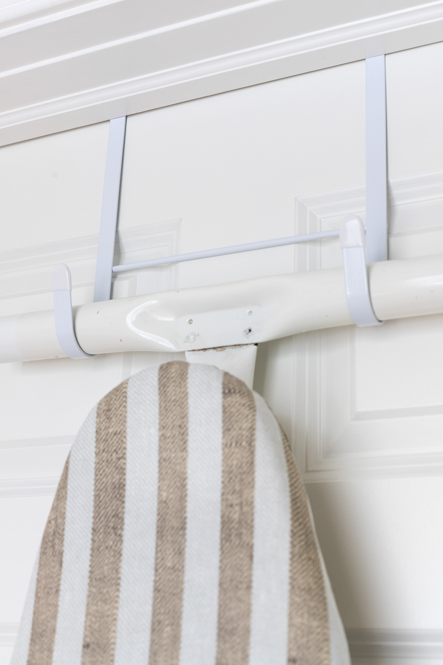 Over the door hanger for an ironing board - such a great space saver!