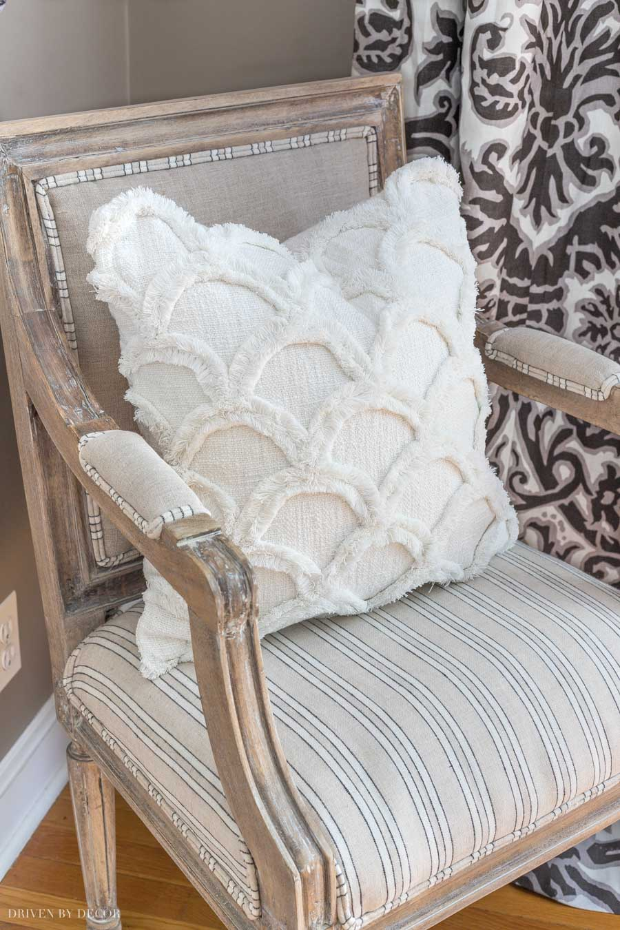 SUCH a cute scalloped white pillow! Love the texture and that it works with everything!