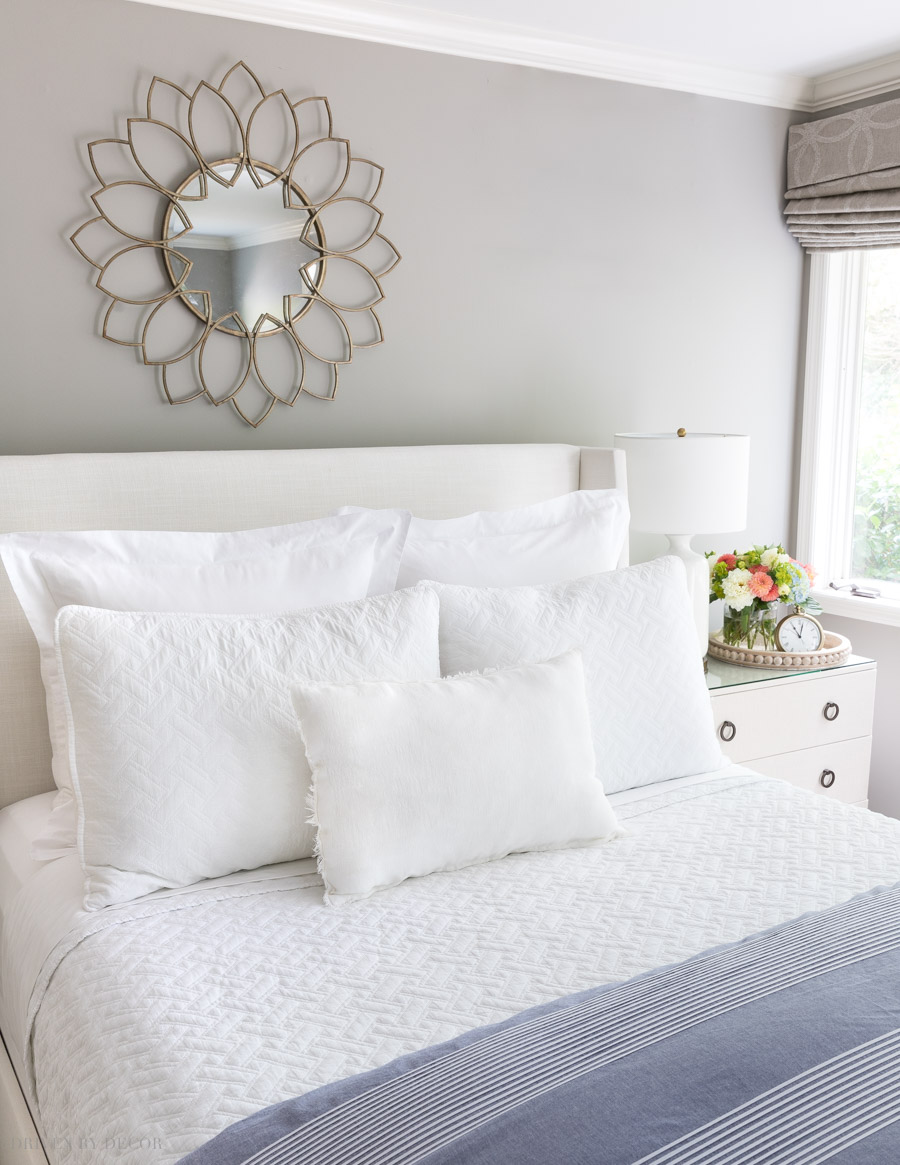 Love this all white look! This post has tons of ideas for arranging your bed pillows in different ways!