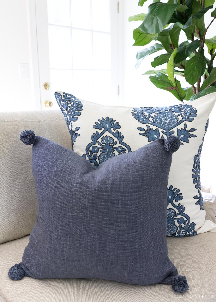 Crushing on these blue and white pillows! Love the pom pom one!