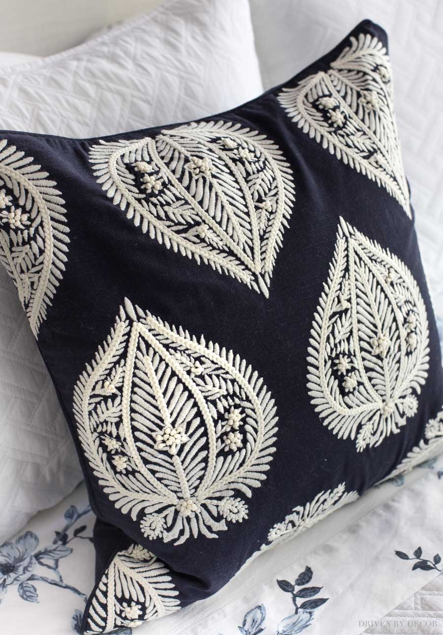 These navy blue and white embroidered pillow covers are gorgeous!! Love how she used them!