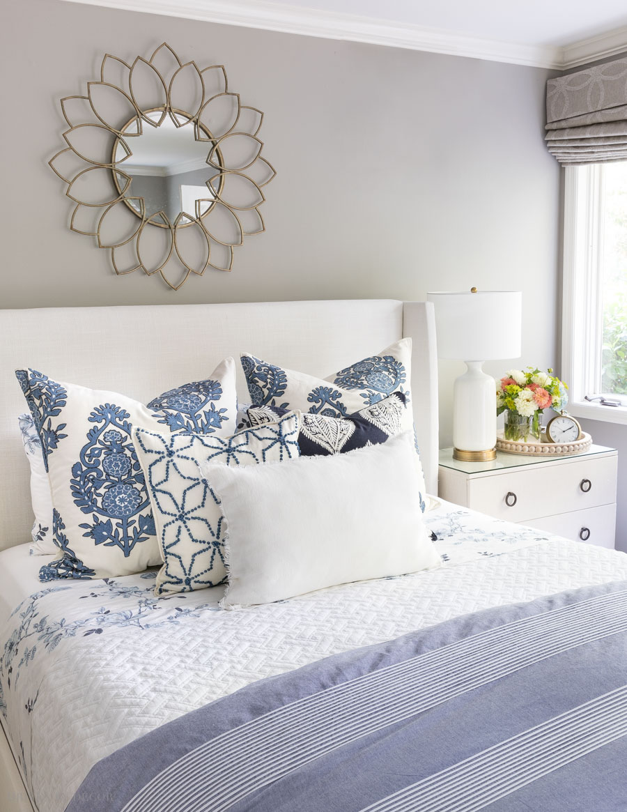 Love the mix of colors and patterns! This post is so helpful for figuring out how to arrange pillows on a bed!