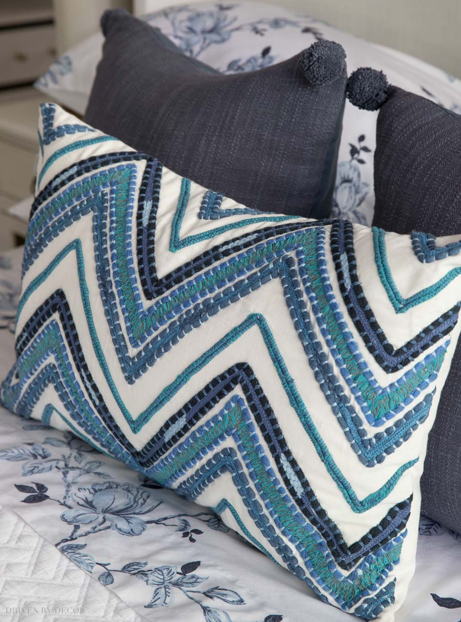 LOVE this embroidered chevron lumbar pillow in the prettiest shades of blue!