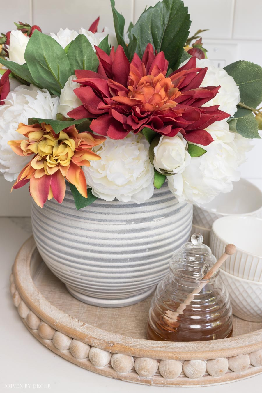 Loving this beautiful wood tray and the fall faux flowers - all of them are linked in this post!