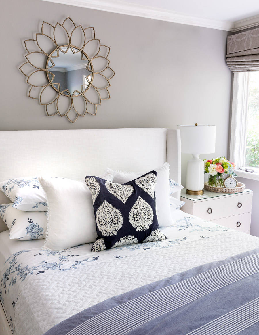 Love how she stacked the sleeping pillows behind the decorative pillows on this bed! Lots of other pillow arranging ideas in this post!