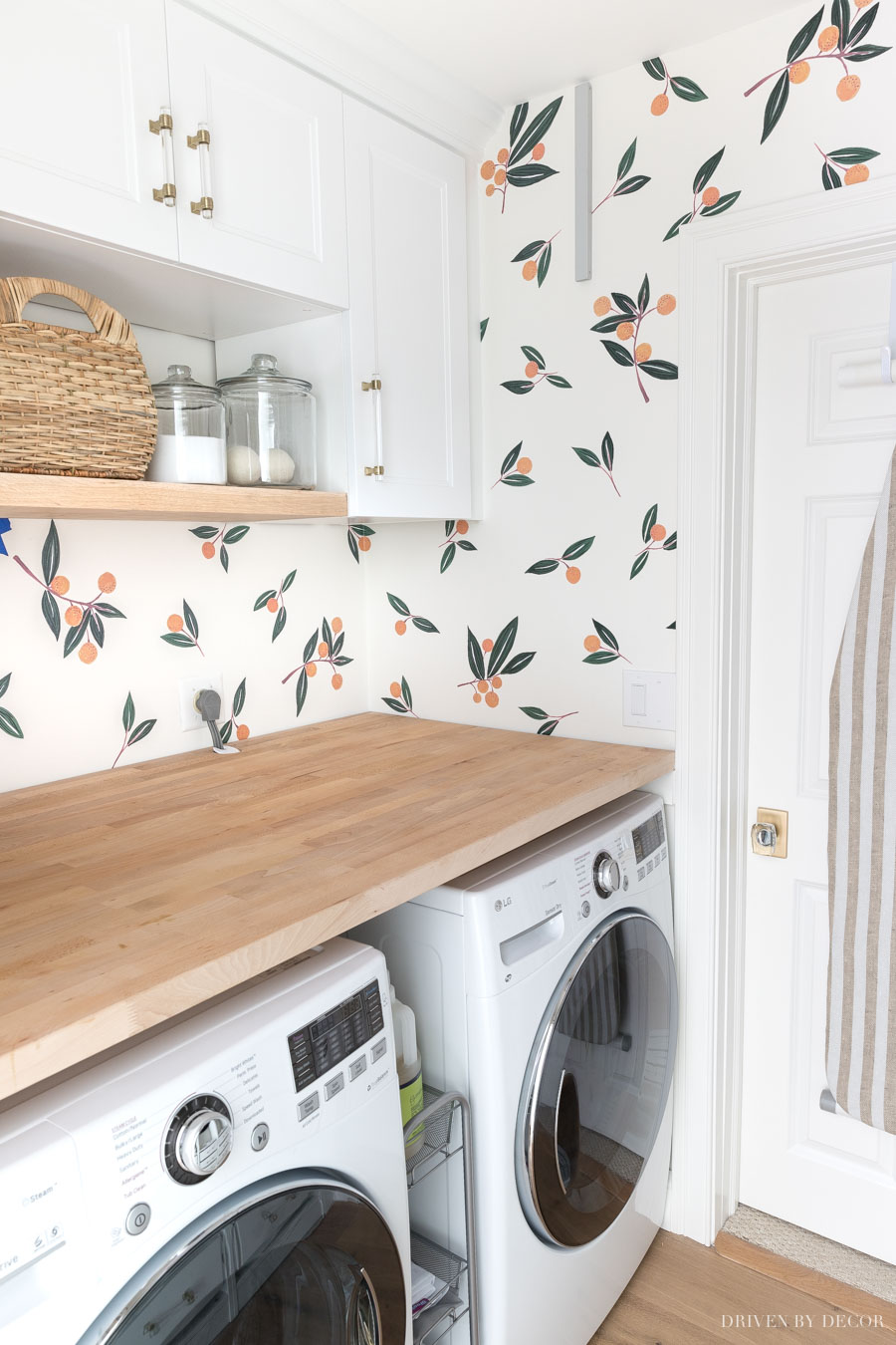 These vinyl wall decals are such a cute and easy way to dress up a space like this laundry room!