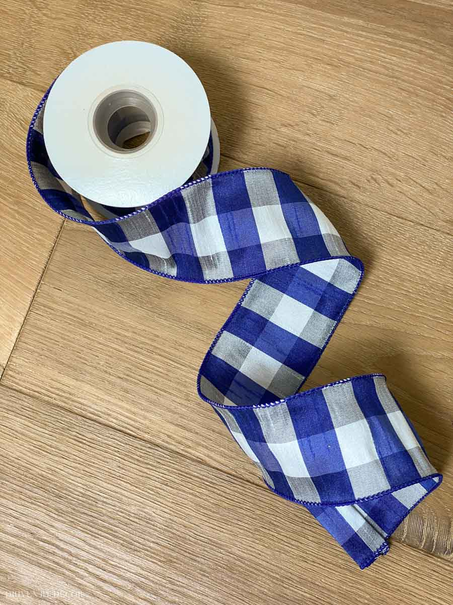 The cutest blue, white, and gray plaid wired ribbon to use on our Christmas tree!