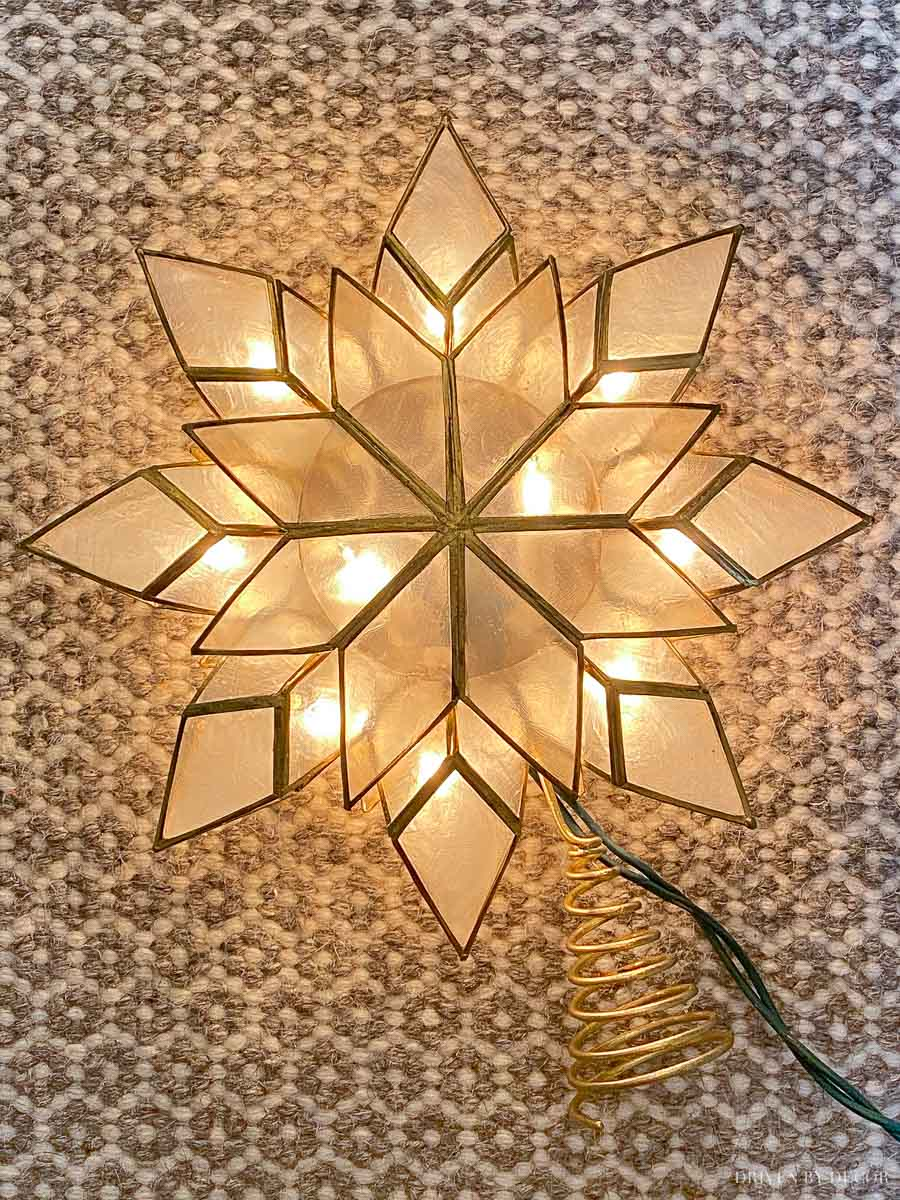 Love this gorgeous capiz star tree topper that lights up!