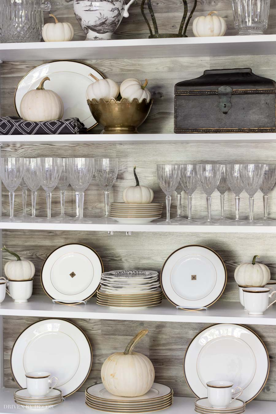 So cute! Baby boo pumpkins dress up this china cabinet for fall!