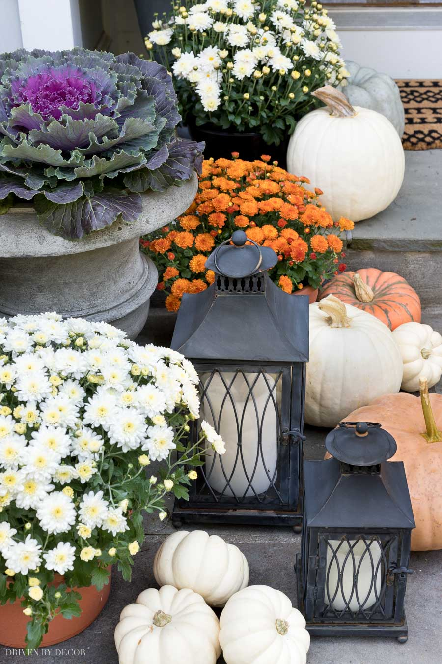 These cute lanterns come as part of a trio (with a third larger one) and are perfect for decorating your front porch!