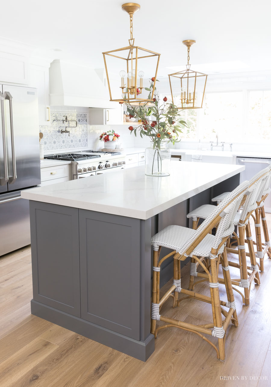 SUCH helpful tips about hanging lights over a kitchen island including how many to use, how far apart, and more!