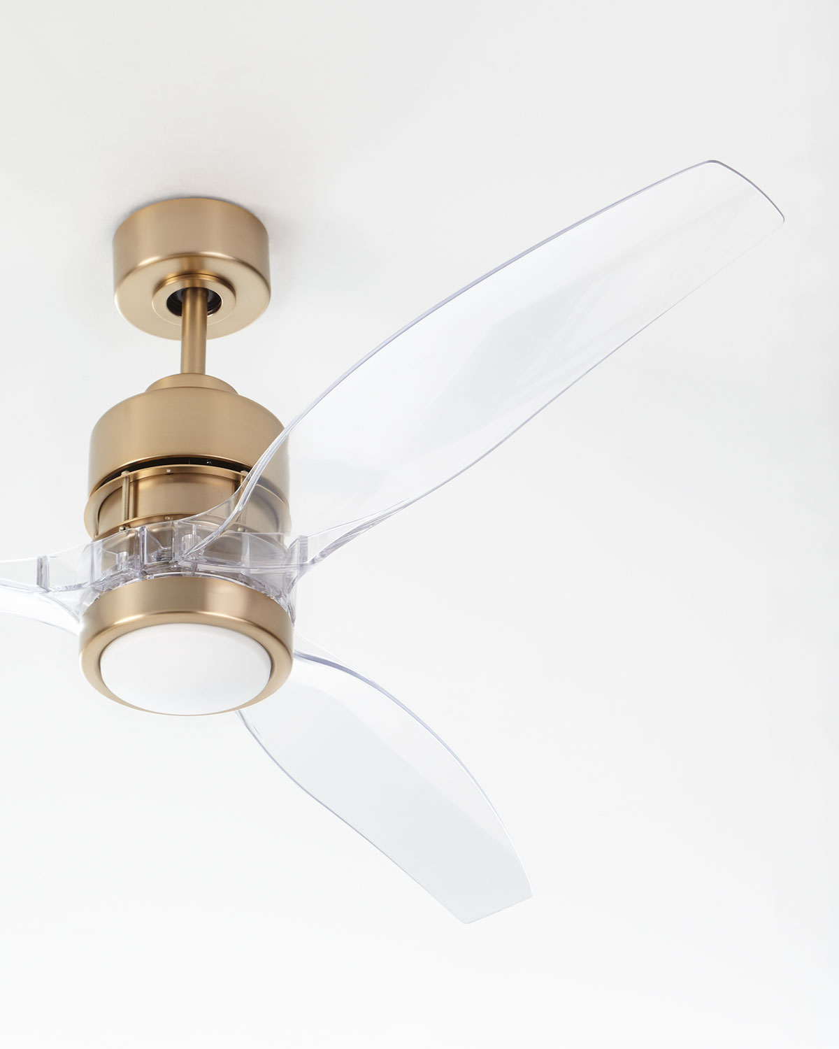 Such a pretty ceiling fan with a satin brass base and acrylic fan blades!