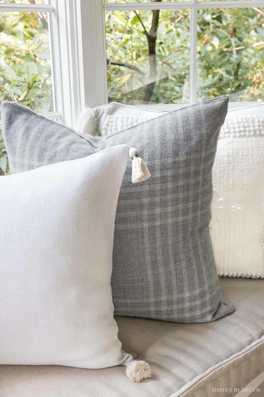 So obsessed in with gorgeous pillows!! The cream tassel end pillows go with everything!!