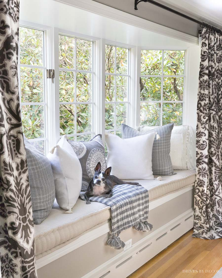 Loving these fall pillows and throw - such a dreamy window seat!