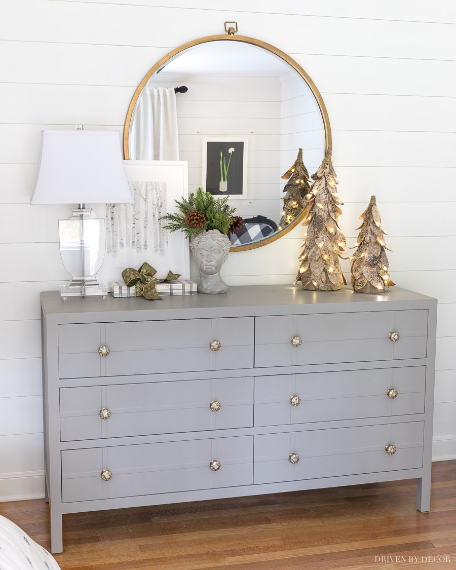 Love this dresser, mirror, and accessories in her bedroom! And those trees are gorgeous for the holidays!