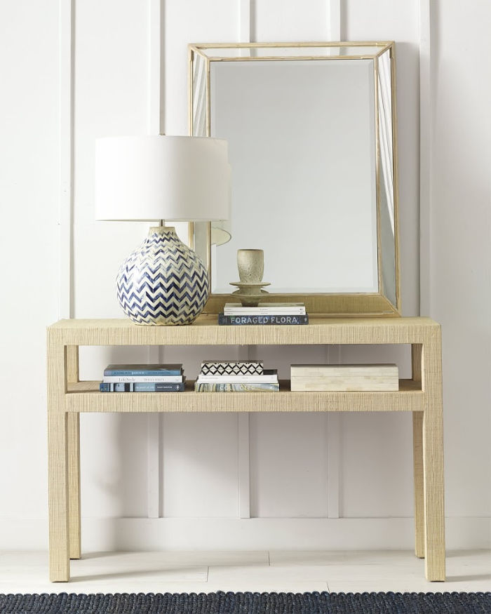 The perfect foyer or entryway piece! Love this raffia console!