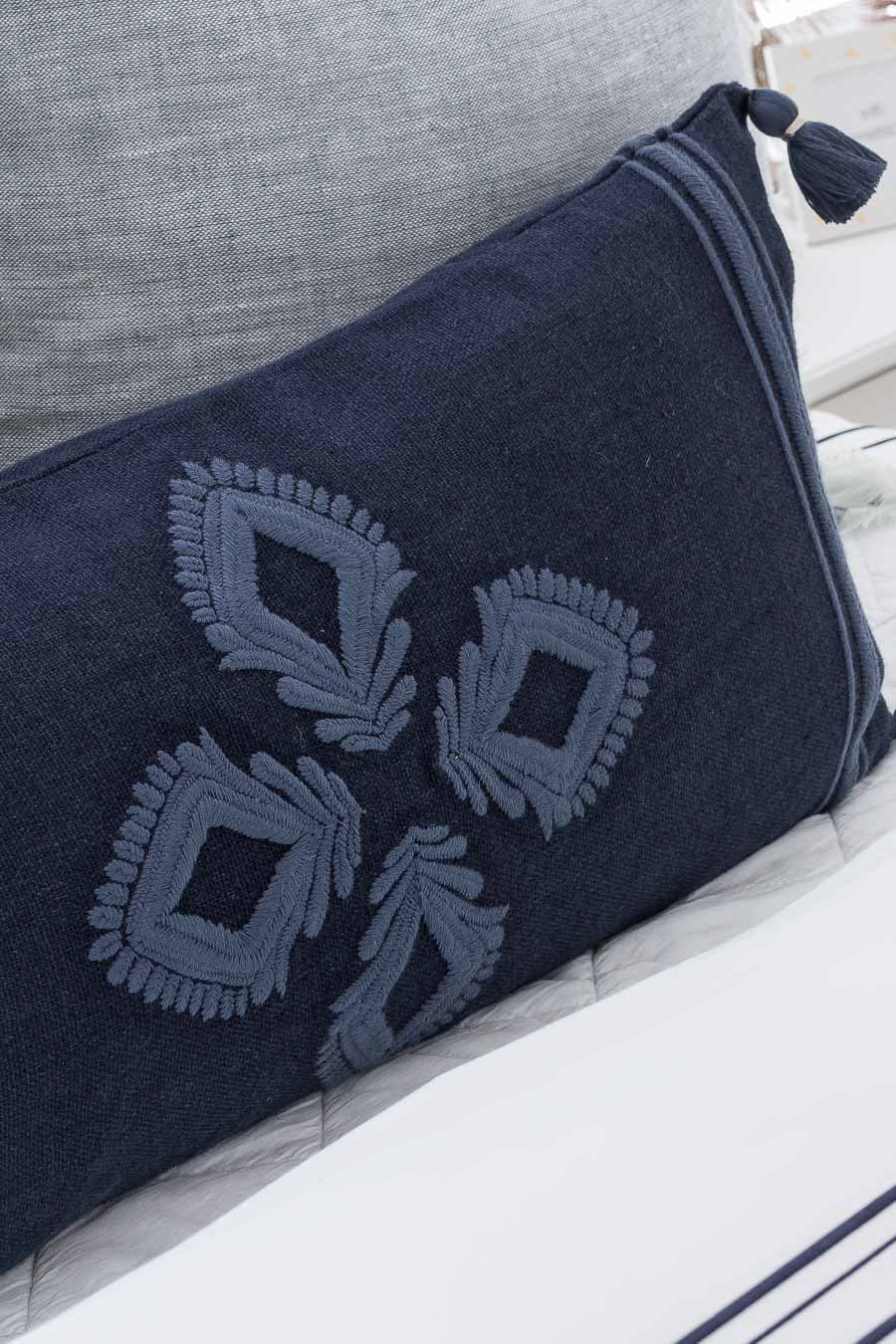 Gorgeous embroidered navy pillow - perfect for the front pillow on a bed!