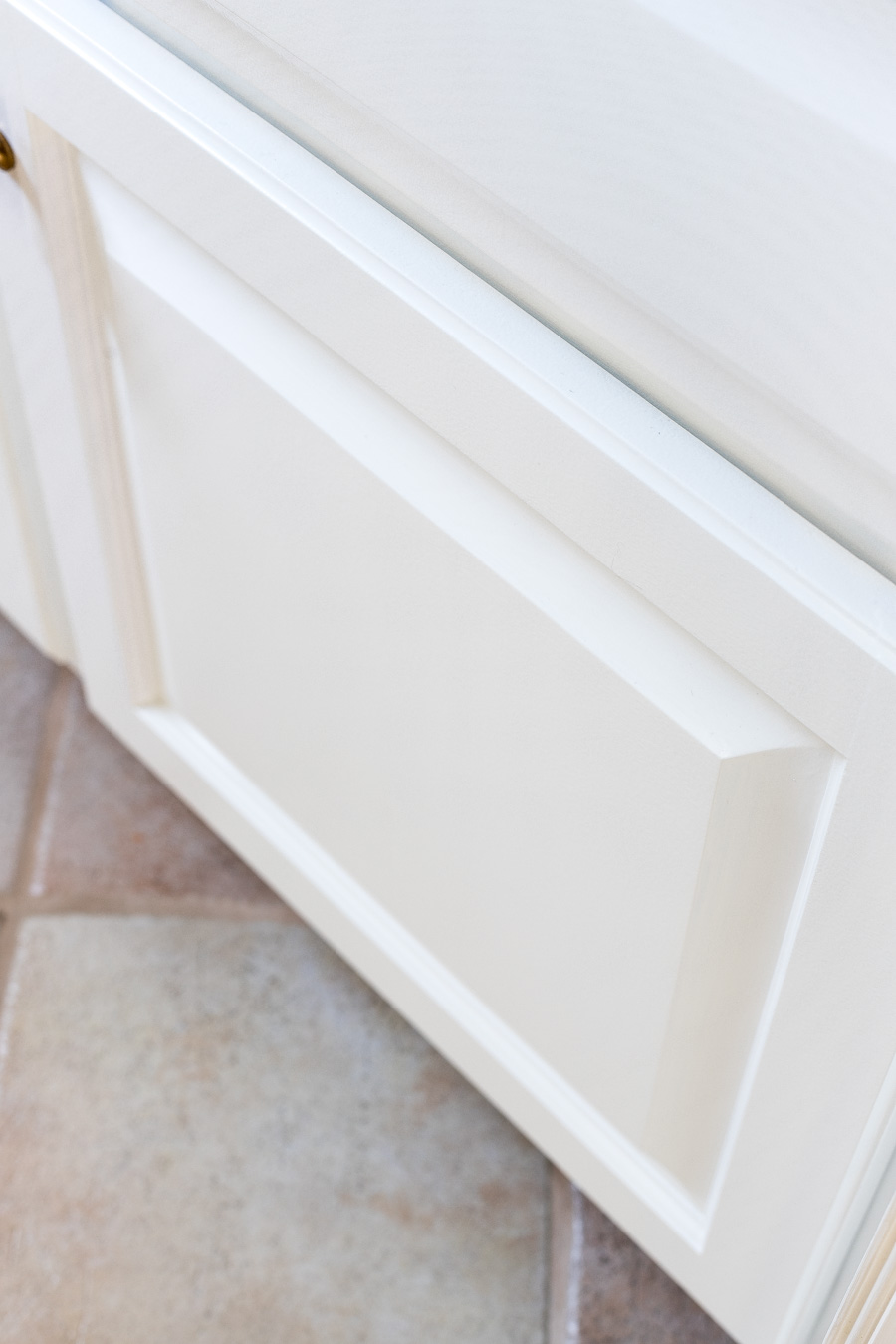 You can get a super smooth finish on painted cabinet doors if you prep and paint the right way!