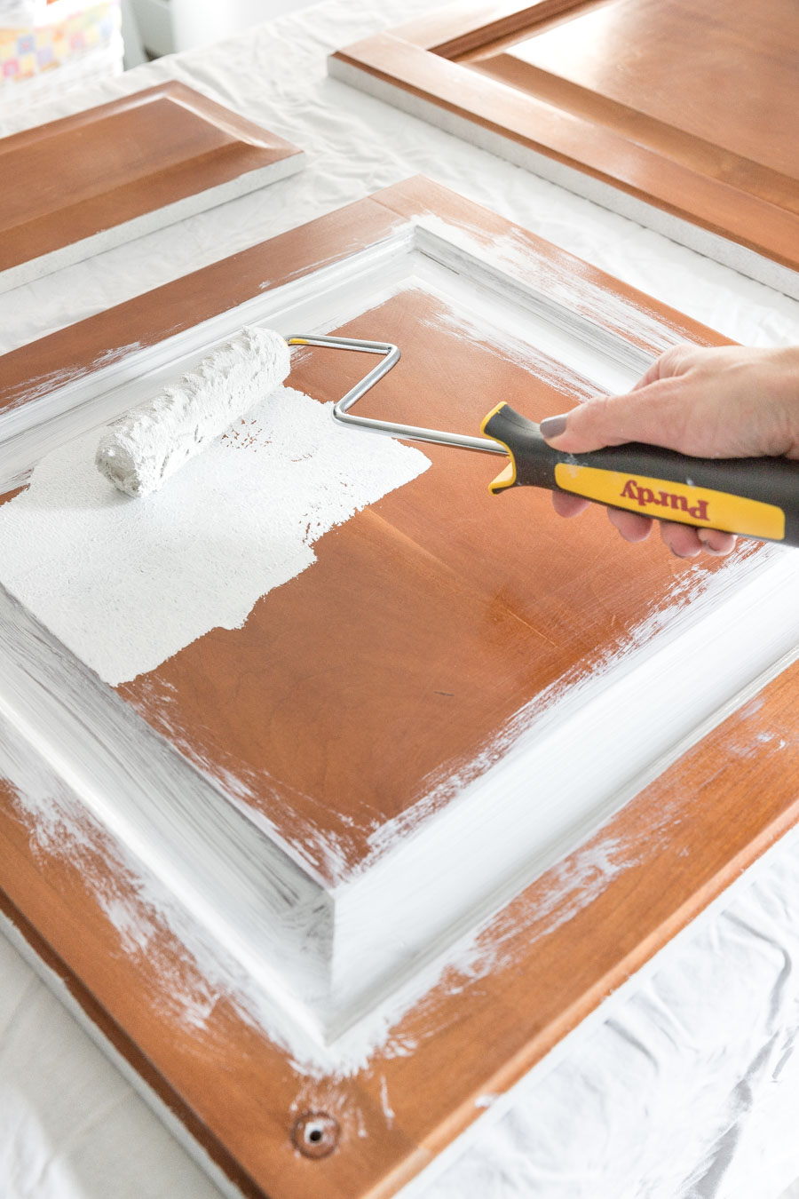 Rollering on the primer is the next step in painting your bathroom vanity