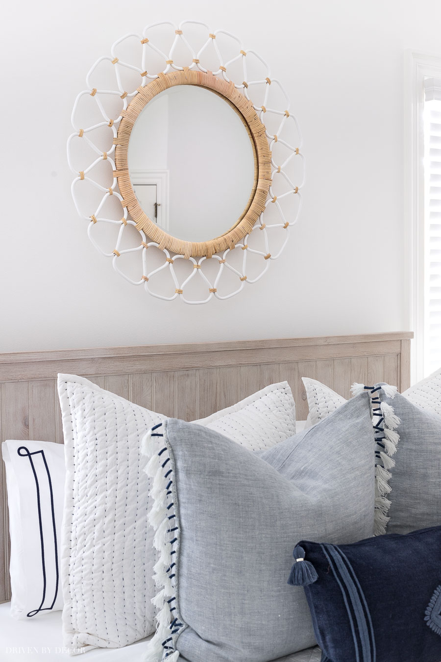 The perfect mirror for above a bed! Love the two-toned rattan!