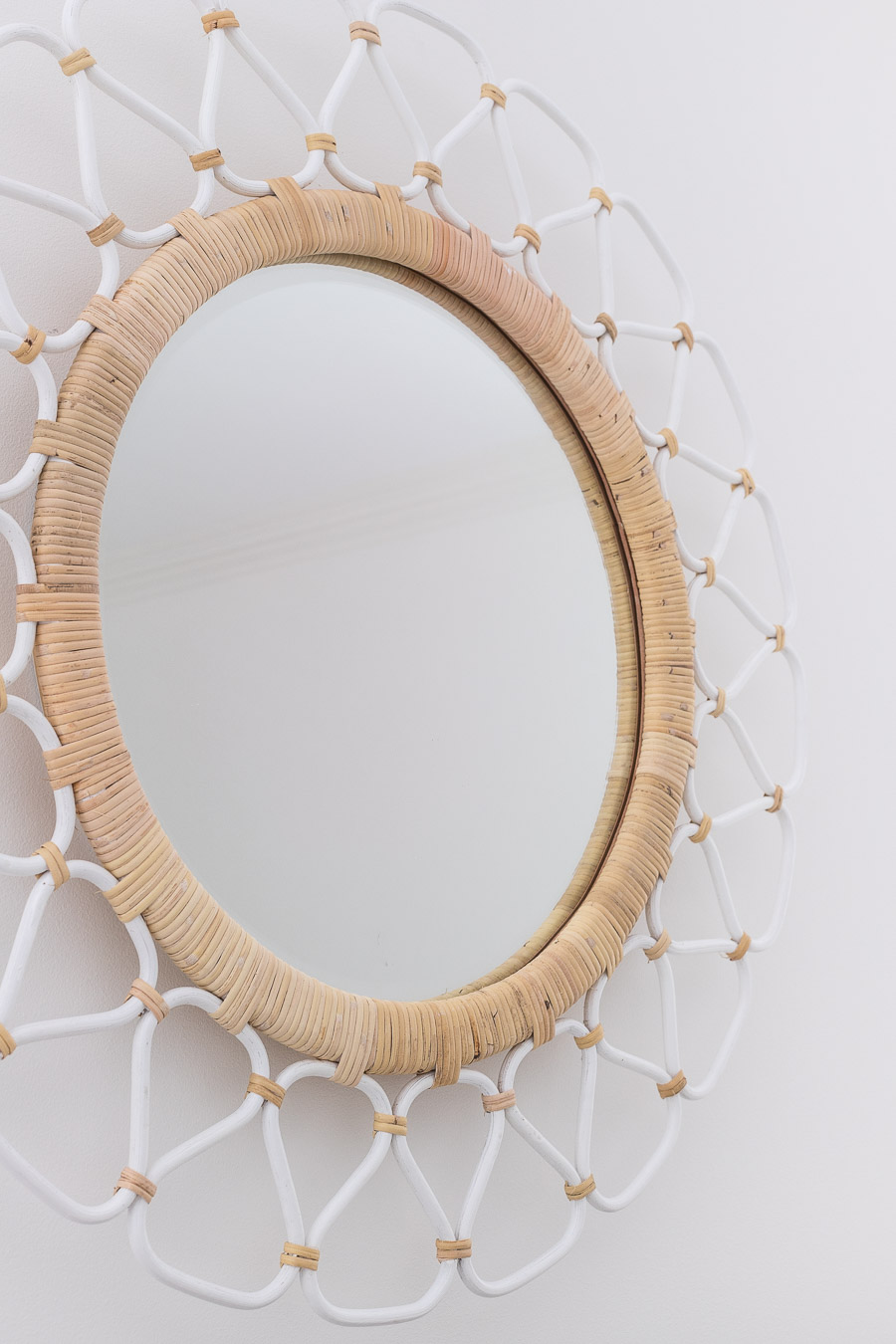This rattan mirror looks so good above her bed! Love the colors and texture!