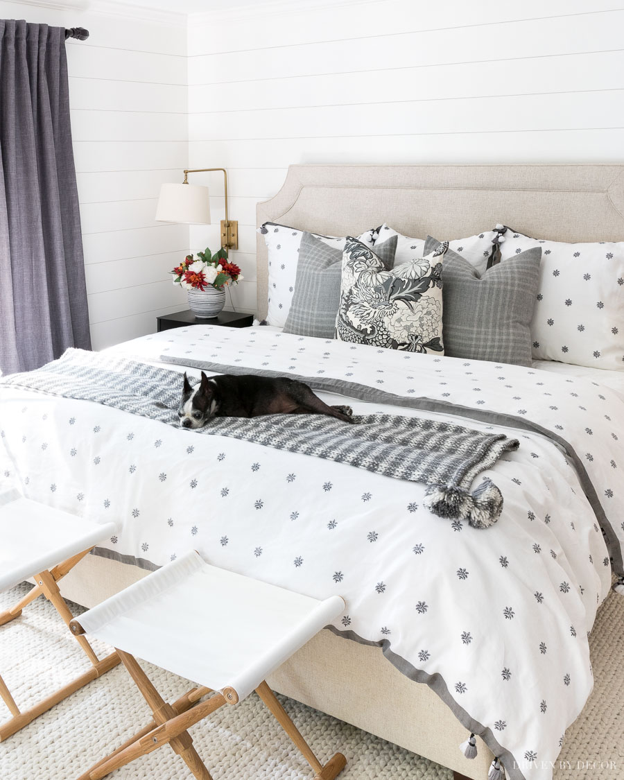 LOVE this gray and white bedding and the camp stools!!