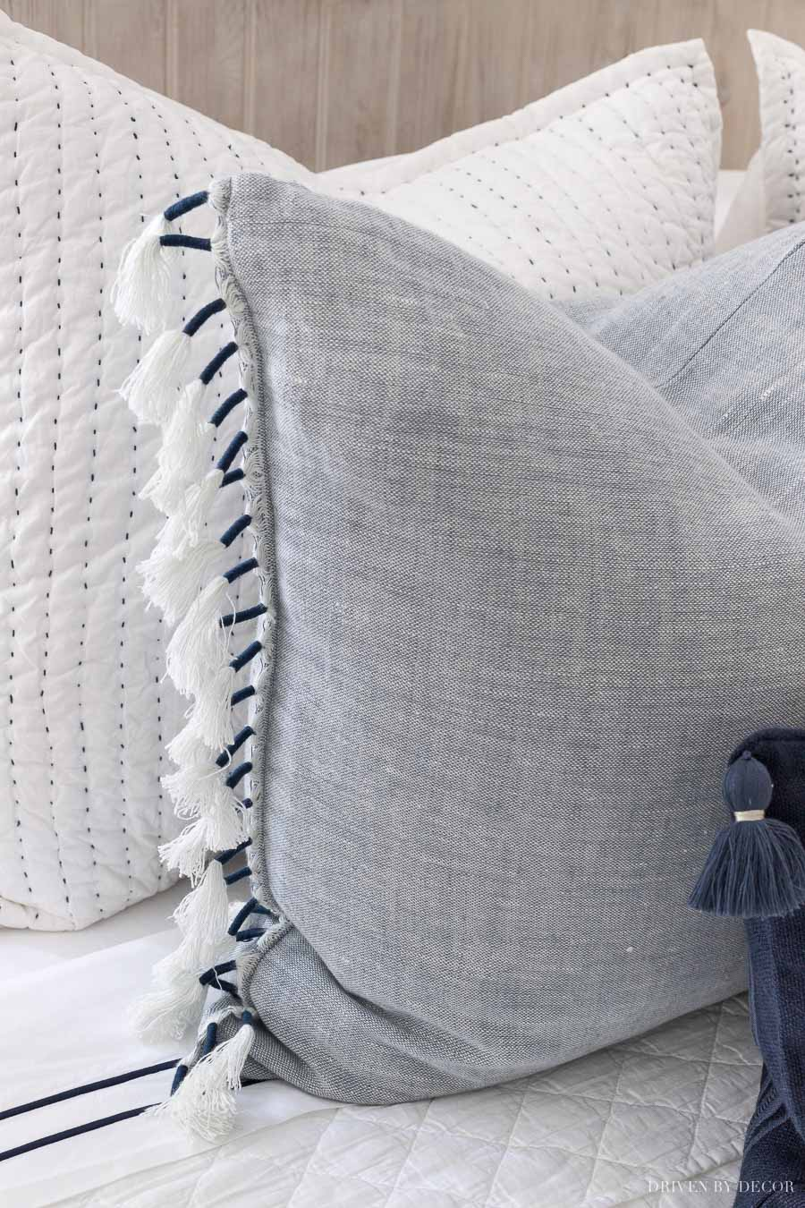 Love the tasseled edges of these blue pillows!