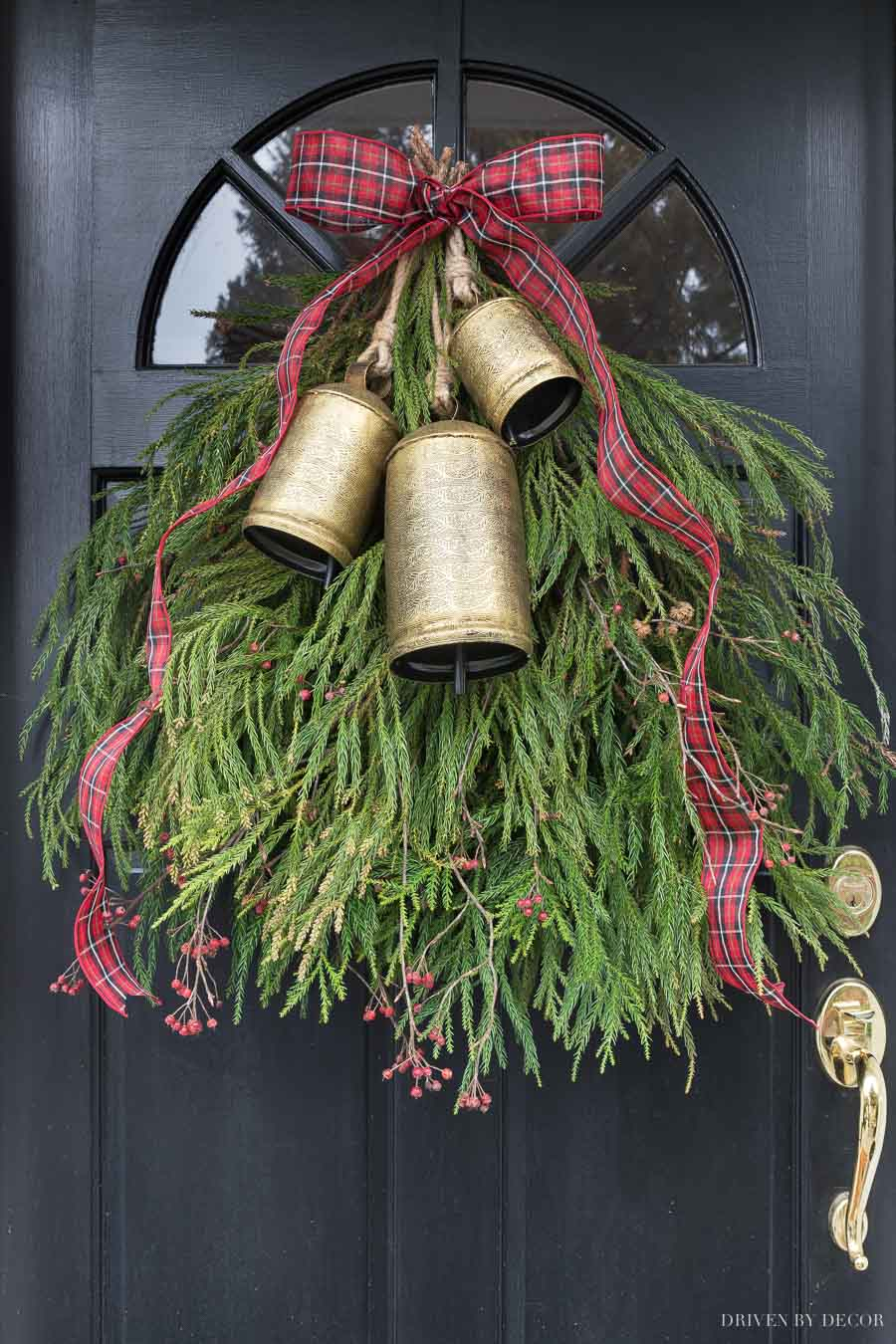 Gorgeous holiday greenery swag with a trio of brass bells and ribbon!