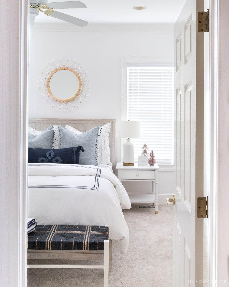 Love the round mirror over this bed!