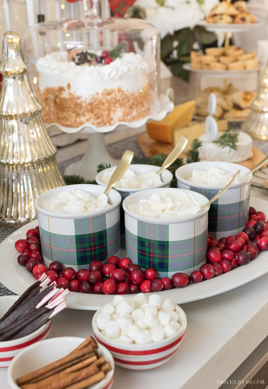 Cranberries add a pretty pop of red to this kitchen island holiday buffet!