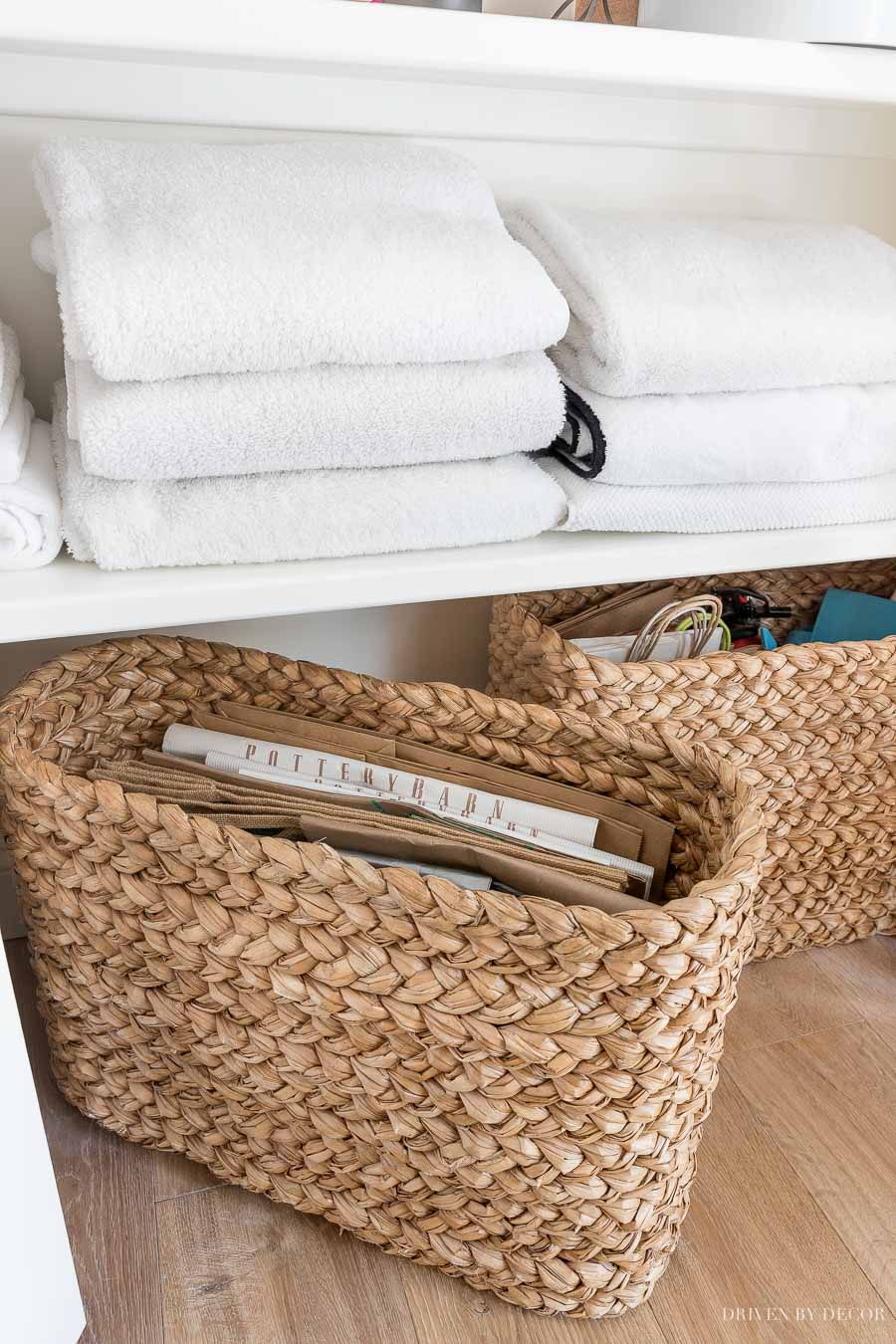 These tall, shallow console baskets work perfectly for storing our grocery and shopping bags!