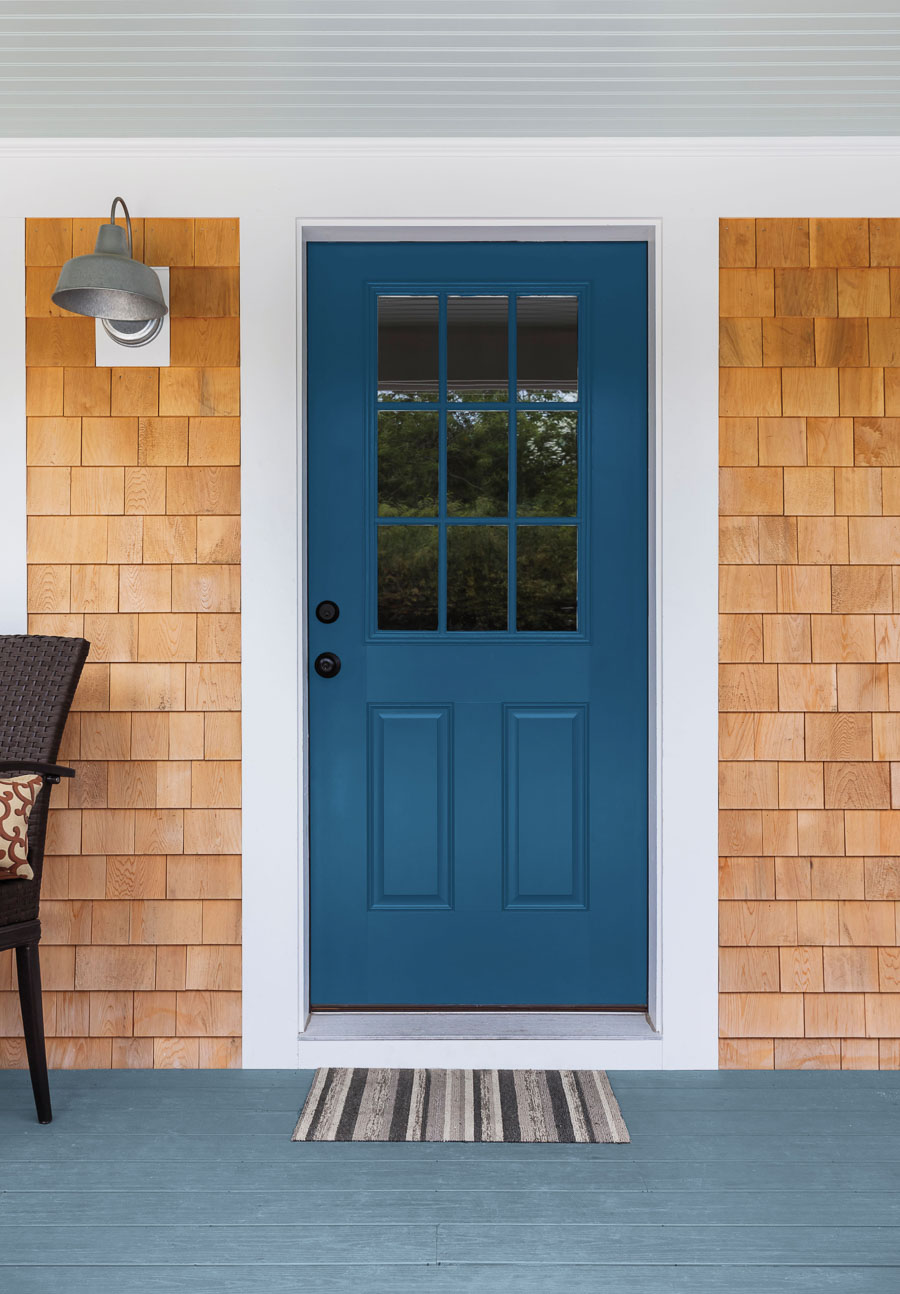 Love this shade of blue for a front door! More details on colors of the year are in this post!