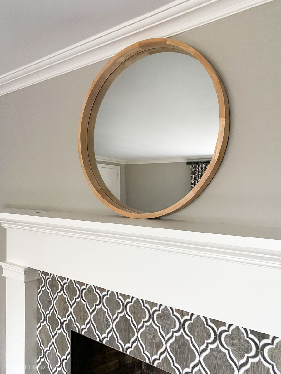 Gorgeous round wood barrel framed mirror!
