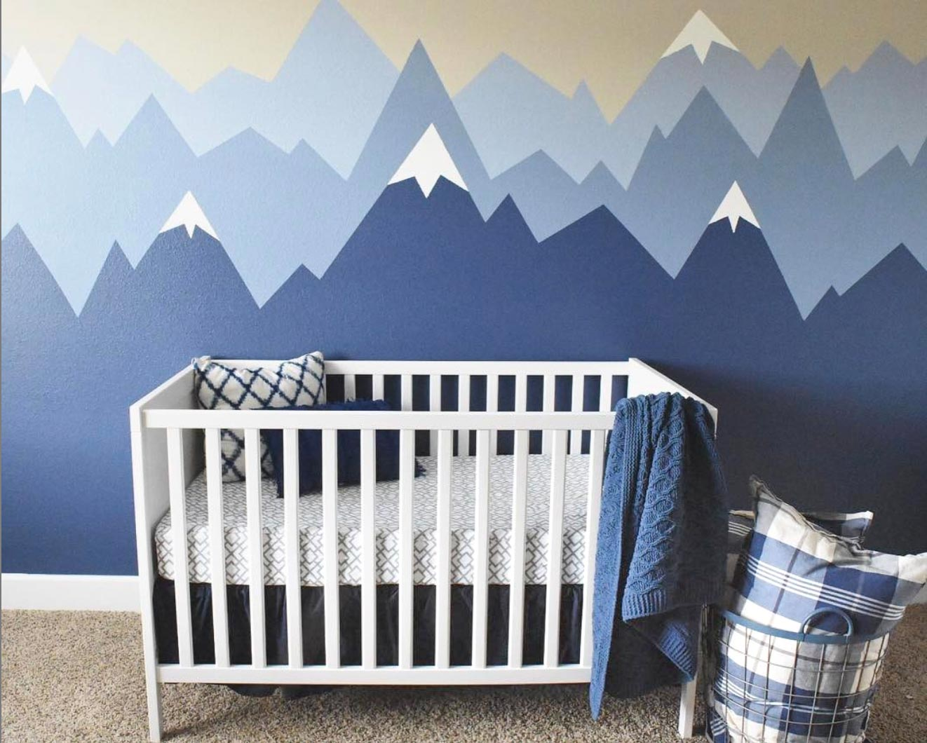 The cutest nursery with painted walls in the prettiest shades of blue!